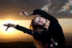 Sunset. One female color sky sunset portrait relaxation poses Stock Image