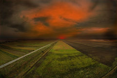 Sunset. Over a green field Royalty Free Stock Image