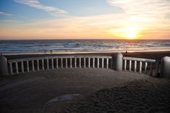 Sunset. Over Pacific Ocean with railing in a foreground Royalty Free Stock Images