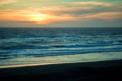 Sunset. Over Pacific Ocean with silhouette of a ship on the horizon Royalty Free Stock Image