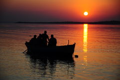 Sunset. People on boat during sunset Royalty Free Stock Photo