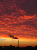 Sunset. Industrial chimney at the sunset, landscape Royalty Free Stock Photos