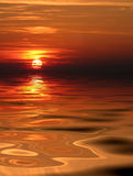 Sunset. On sea with clouds Stock Photography