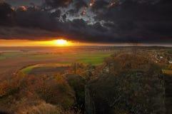 Sunset. Huge cloud and the setting sun stock photos