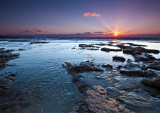 Sunset. Peaceful rocky shore during sunset Royalty Free Stock Photography
