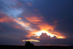 Sunset. Sun shining through the clouds stock photo