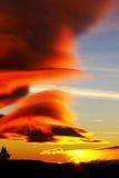 Sunset. The sun shining through cloud,sunset Stock Images