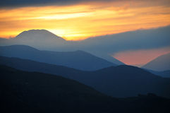 Sunset. Layered mountains in the sunset Stock Images