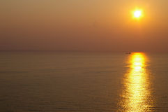 Sunset. Over water, golden glow over calm ocean or lake Royalty Free Stock Photo