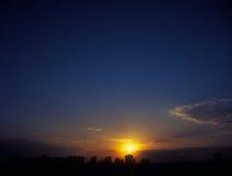 Sunset. Beautiful sunset over a dark cityscape Royalty Free Stock Photos