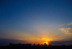 Sunset. Beautiful sunset over a dark cityscape Royalty Free Stock Photo