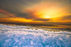 Sunset. Above drifting ice at a dutch lake Royalty Free Stock Image