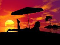 Sunset. Young woman and beach,sunset and beach,palm and island Royalty Free Stock Images