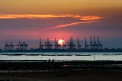 Sunset. Sea land sun cloud Stock Image