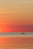 Sunset. Fishermen in a boat at sea at sunset Stock Images