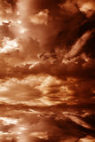 Sunset. Red sunset over the sea, rich in dark clouds Stock Images