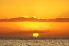 Sunset. Golden sunset sky above sea surface Royalty Free Stock Photo