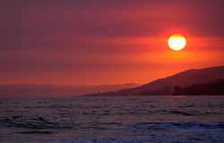 Sunset. Californian beach sunset with red skies Royalty Free Stock Photography