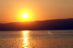 Sunset. Beautiful summer sunset with water reflection Royalty Free Stock Images