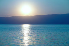 Sunset. Beautiful summer sunset with water reflection Stock Image