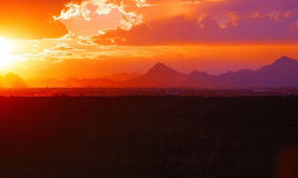 Sunset. By Tuscon with clouds and mountain range in background Stock Photography