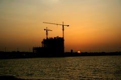 Sunset. Construction on an arabian beach royalty free stock image