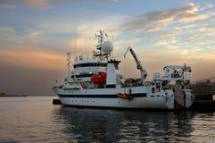 Sunset. Science ship visiting Las Palmas in Spain Stock Photos