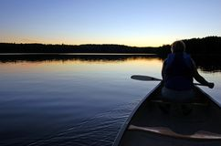 Sunset. And canoe trip in calm lake in Algonquin Park Stock Image