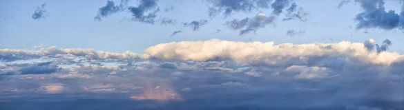 Before sunset. Dark sky and yellow clouds. Before sunset Stock Photos