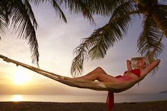 After sunset. View of a woman lounging in hammock during sunset Royalty Free Stock Images