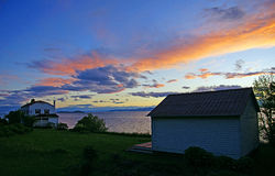 Sunset. Sun setting over a waterfront property on the St. Lawrence River in Quebec Stock Photography