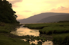 Sunset. River leading into a loch at sunset Royalty Free Stock Images