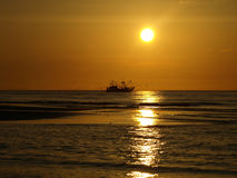 Sunset. Fishing boat in the sunset Stock Photo