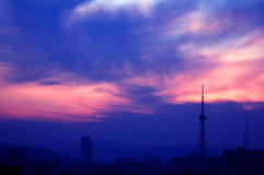 Sunset. With orange clouds,Urumchi Stock Images