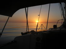 Sunset. From sailing sloop approaching Grand Bahama Island Royalty Free Stock Images