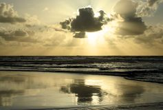 Sunset. Reflex on the beach royalty free stock photography