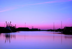Sunset. Silhouette of a harbor with a purple and pink sunset Stock Image