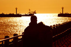 Sunset. Over the sea - a walk in the sea port Royalty Free Stock Images