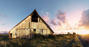 Sunset at an Abandoned Barn, Color Image. Evening, Sunrays stock photo
