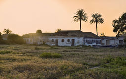 Sunset abandoned fishing village. Sunset in an abandoned fishing village with homes of fishermen and boats used for artisanal fisheries Royalty Free Stock Photo