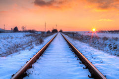 Sunset on the abandoned railway tracks - HDR Image Stock Photography