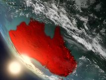 Sunset above Australia from space. Illustration of Australia as seen from Earth's orbit during sunset with visible country borders. 3D illustration. Elements Royalty Free Stock Images