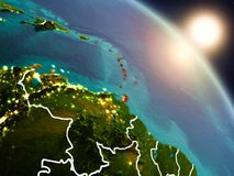 Caribbean from space during sunrise. Sunset above Caribbean from space on planet Earth with visible country borders. 3D illustration. Elements of this image Stock Photo