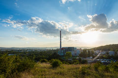 Sunset above the chimney, chemical industry. Sunset above the city chimney, chemical industry stock photography