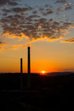 Sunset above the chimney, chemical industry. Sunset above the city chimney, chemical industry royalty free stock photo