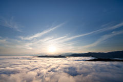 Sunset above clouds Stock Photos