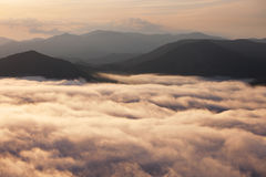 Sunset above clouds Royalty Free Stock Images