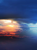 Sunset above clouds from airplane window Stock Photo