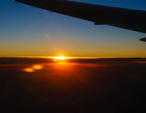 Sunset above the clouds flying a plane Royalty Free Stock Photography