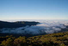 Sunset above the clouds. Reunion, near Piton de la Fournaise Royalty Free Stock Images